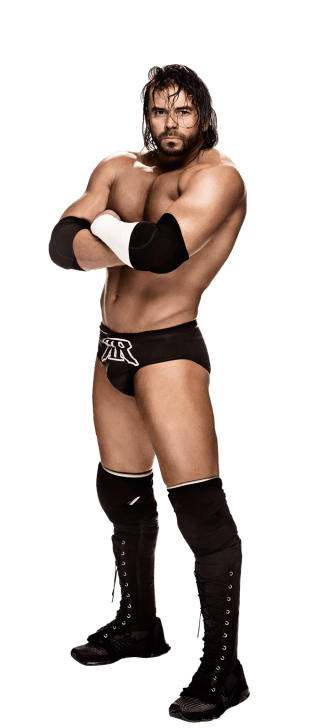 Alex Riley stands with arms crossed in his ring gear