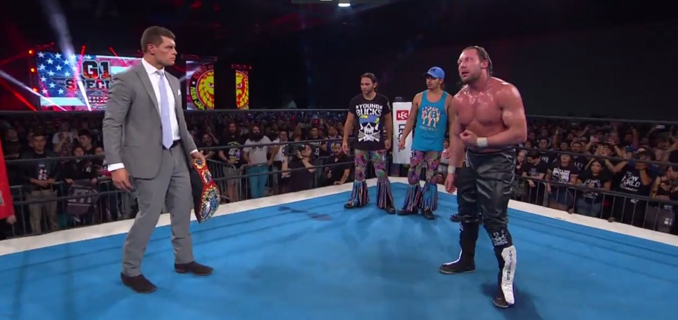 Cody and Kenny Omega, both members of the Bullet Club, stare each other down in the ring after Cody snatched the IWGP US title away from his stablemate
