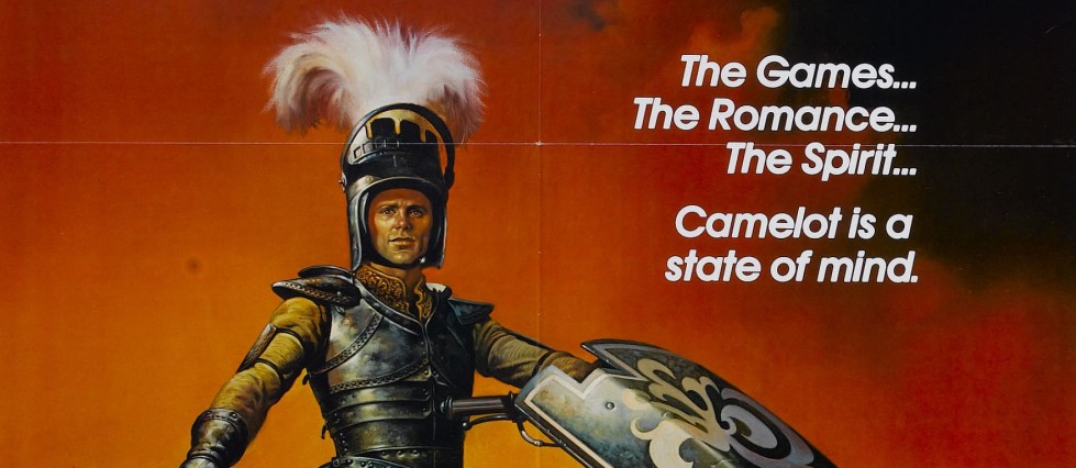 "The poster for Knightriders (1981) painting of Ed Harris shows him in his jousting armor and the text for the tagline: ""the games, the romance, the spirit, camelot is a state of mind"""