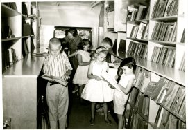 Children choosing books inside the Northeast Regional Library Bookmobile in Corinth, MS.