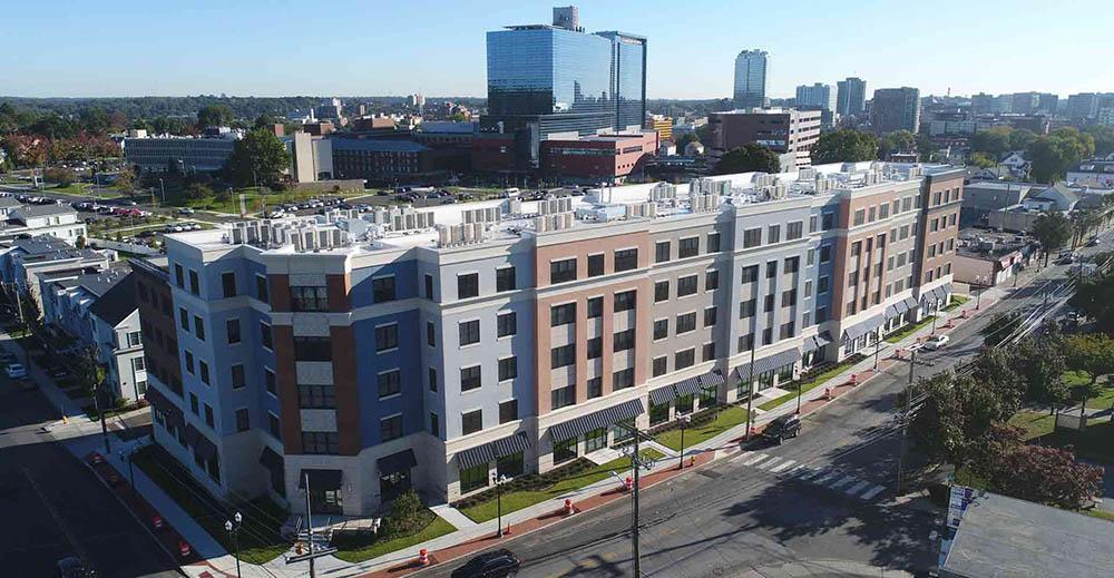 Kenneth Boroson Architects designed Park 215 holds ribbon