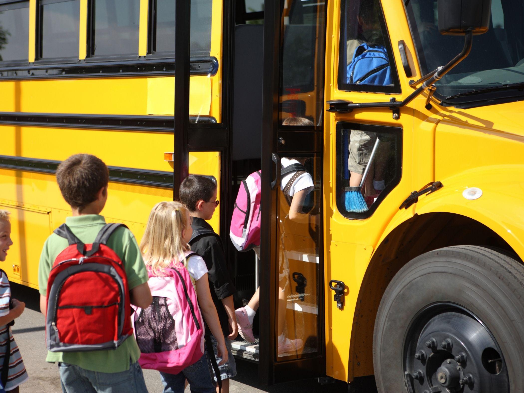 Kids loading bus
