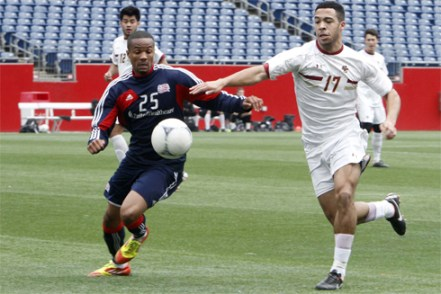 BC striker Charlie Rugg (right) battles New England Revolution defender Darrius Barnes in a February exhibition match at Gillette Stadium. (Photo: Chris Aduama/aduama.com)