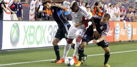 Dimitry Imbongo holds off two defenders in Saturday's win over the San Jose Earthquakes. (Photo: Chris Aduama/aduama.com)