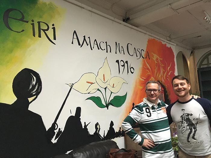 Matt and James stand in front of a commissioned Mural at Omnibus Theatre