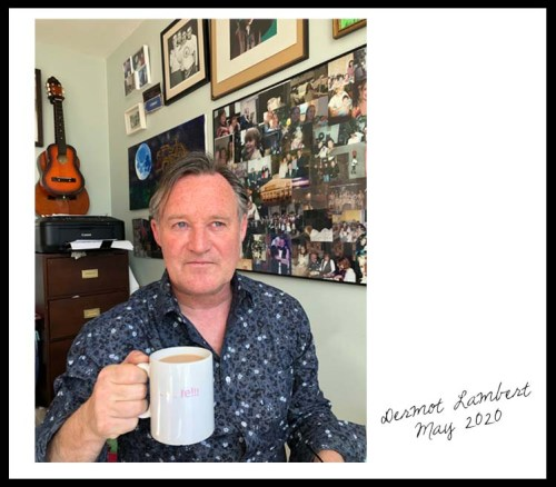 Dermot Lambert with a cup of tea in his home office