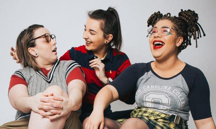Cherym promo shot - three girls laughing - background is grey. Taken by ycontrolphotography.com