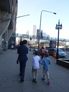 The First Communion boy, in white too, walking through Draft Town.