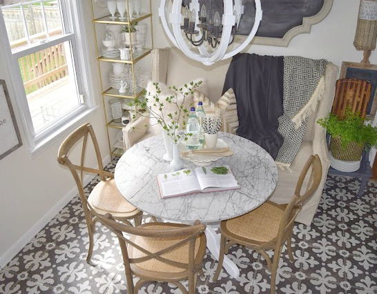 White Kitchen remodel with patterned tile and butcher block counter tops. Eat-in banquette.