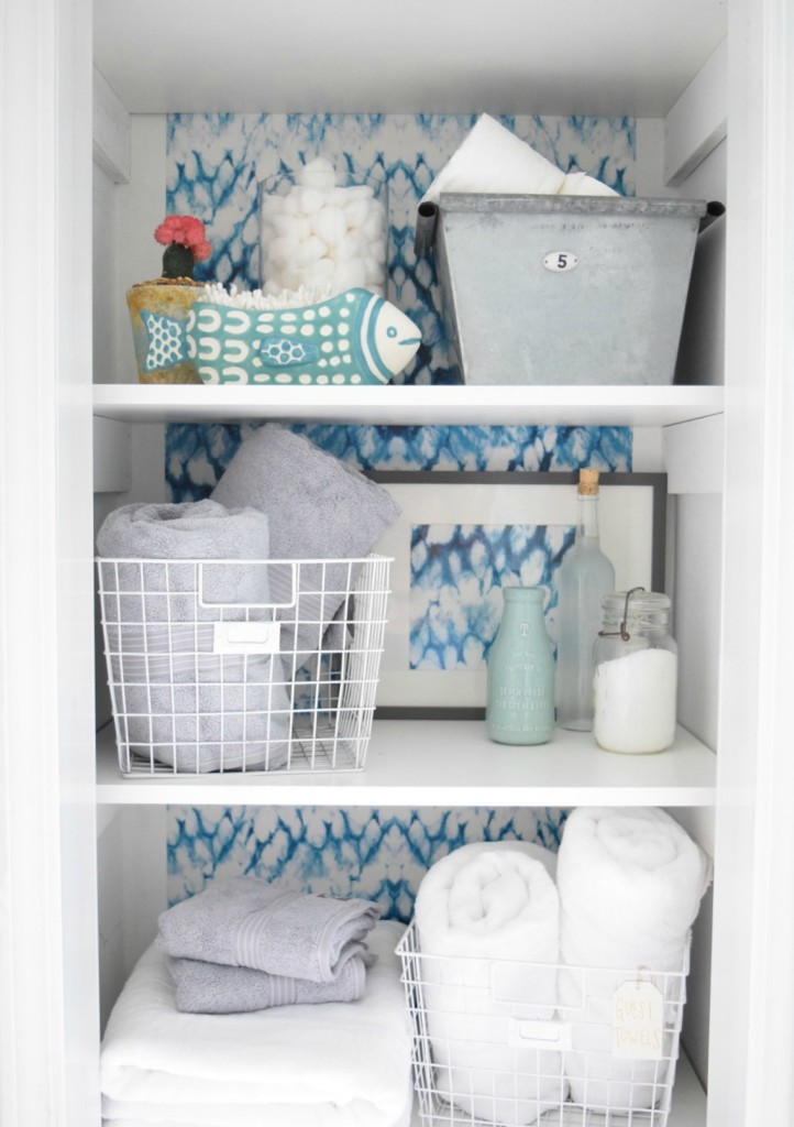 Organizing a closet in a bathroom with wallpaper