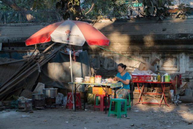 Woman selling street food in Mandalay