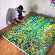 Abstract Painter Nestor Toro working on a commissioned painting for client