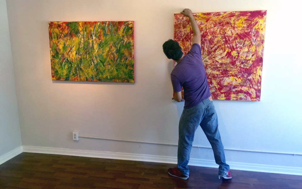 Artist Nestor Toro - Installing Artwork For Solo Show