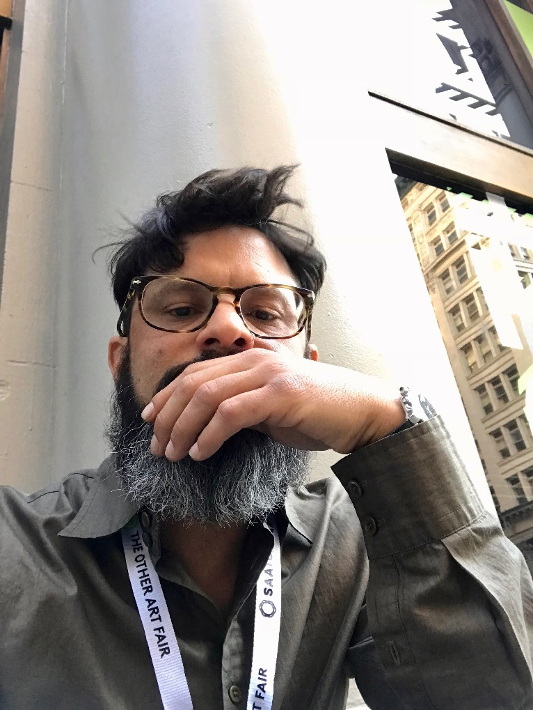 Artist Nestor Toro taking a break at a show in L.A. 2018