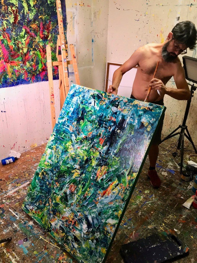 Nestor Toro working in the studio on one of his original 1 of a kind paintings getting it ready for shipping anywhere in the world