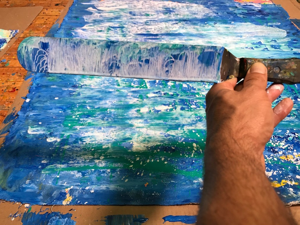 Palette Knife with paint in a traditional signature shot I like to take of my work. It is creative as well as captures a moment of creation while the work is being made sort of like.