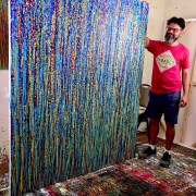 Studio view of Nestor Toro and his work Blue Satin Drizzles - arrives with sides painted and ready to hang!