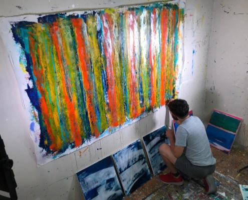 "Artist Nestor signing his work ""Fearlessness"""