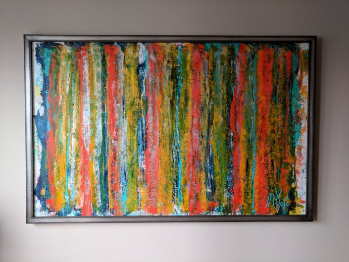 Framed abstract painting in bedroom