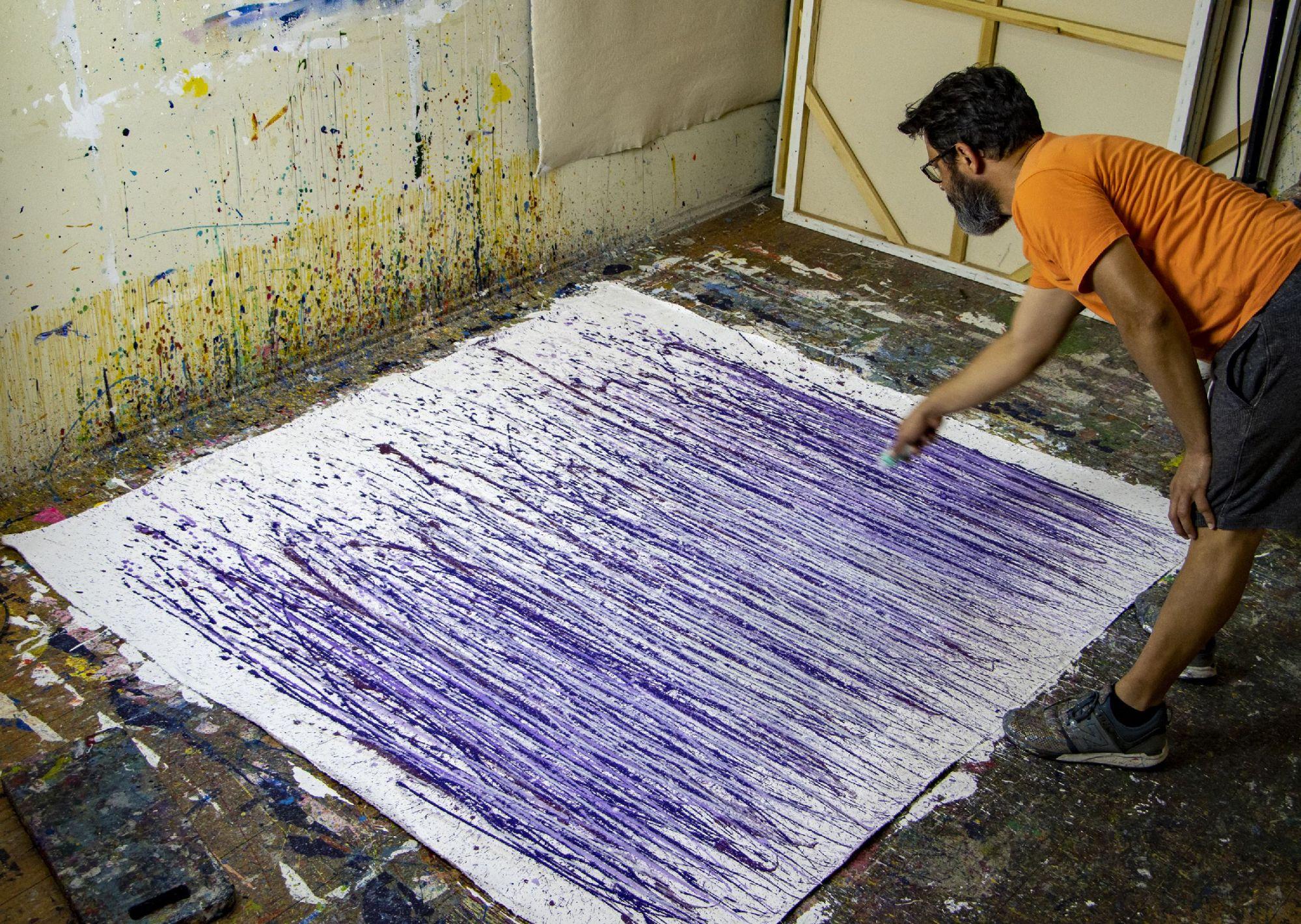 Nestor Toro working on the painting