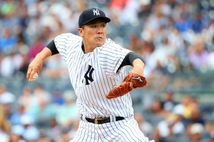 NEW YORK, NY - JULY 09: Masahiro Tanaka #19 of the New York Yankees pitches in the first inning against the Oakland Athletics at Yankee Stadium on July 9, 2015 in the Bronx borough of New York City. (Photo by Mike Stobe/Getty Images)