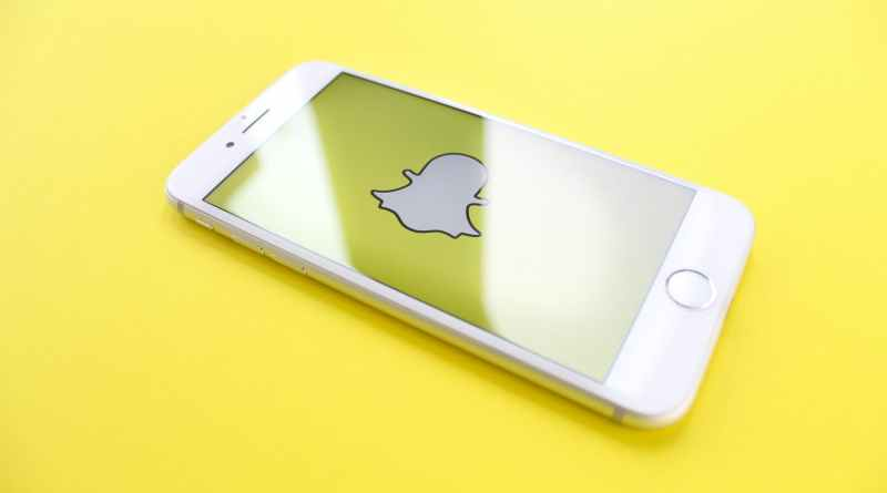 iphone on yellow surface