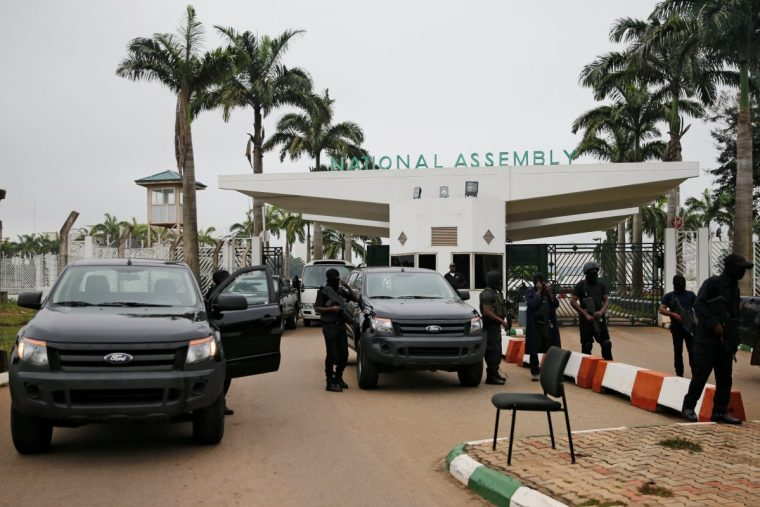 Armed men block entrance to Nigeria's parliament, minority leader quits