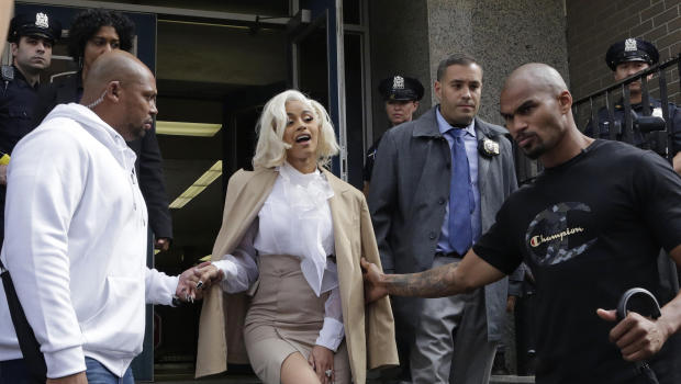 Cardi B charged with reckless endangerment and assault, turns herself in to police