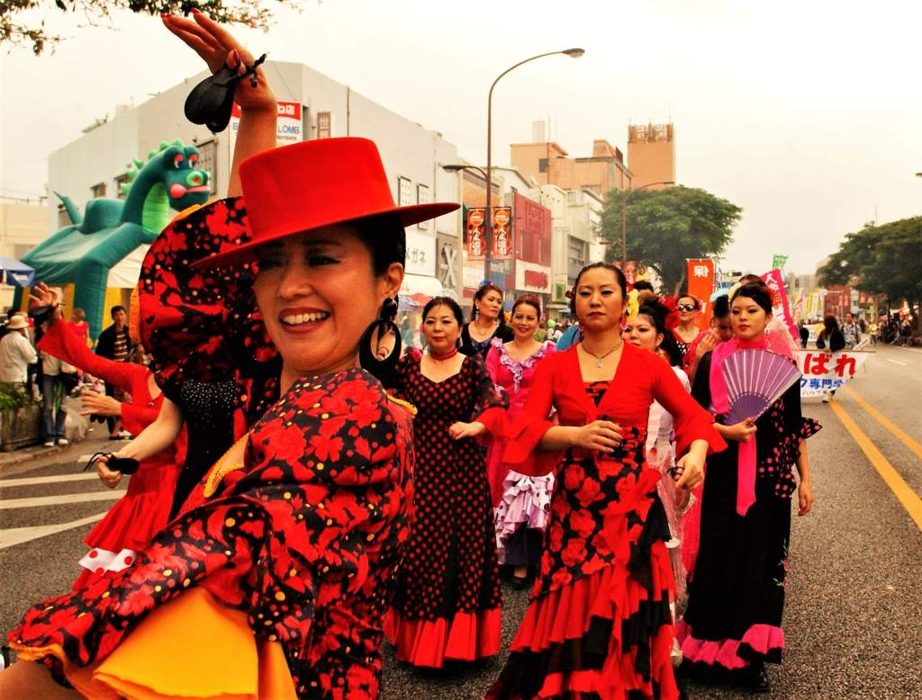 Women dancing on the street in costumes, cultural differences and internationalization