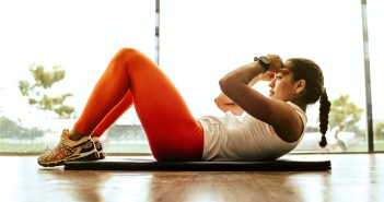 woman exercising abdominal crunch