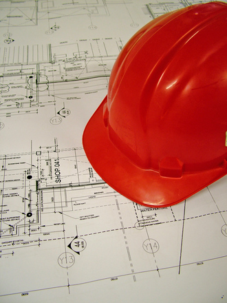 builders hat on house plans, contractor