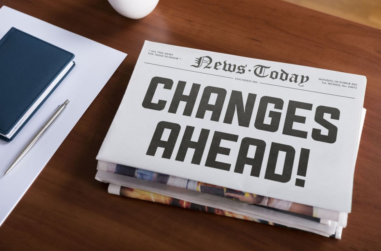 "Newspaper on desk that says, ""News Ahead!"""