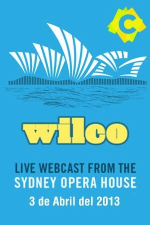 Wilco - Opera House. cartel celeste con amarillo de wilco con el Opera house de sydney en blanco