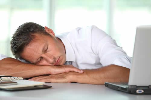 bigstock-Businessman-asleep-on-his-desk-16988432