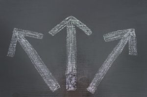 arrows on the floor indicating different paths to choose