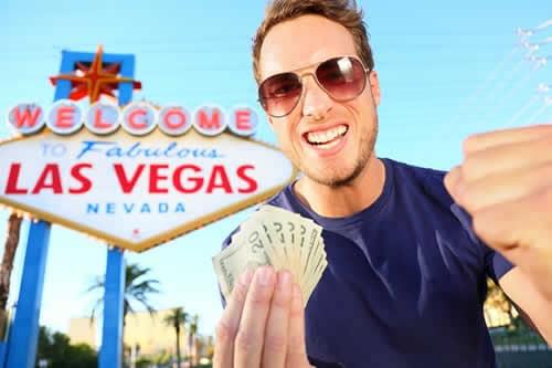 bigstock-Las-Vegas-man-winning-money-W-36640525