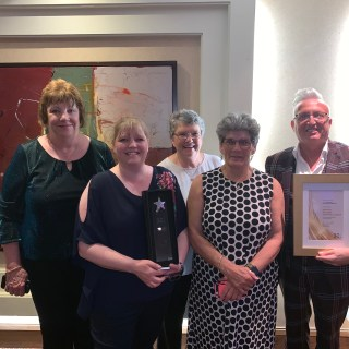 Picture tenants and staff with Most Inspiring Scrutiny Group Award