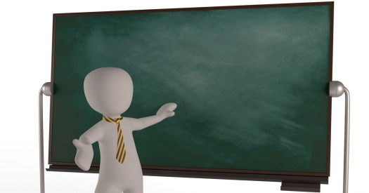 The picture shows an univerity teacher in front of a blackboard with an explanatory gesture