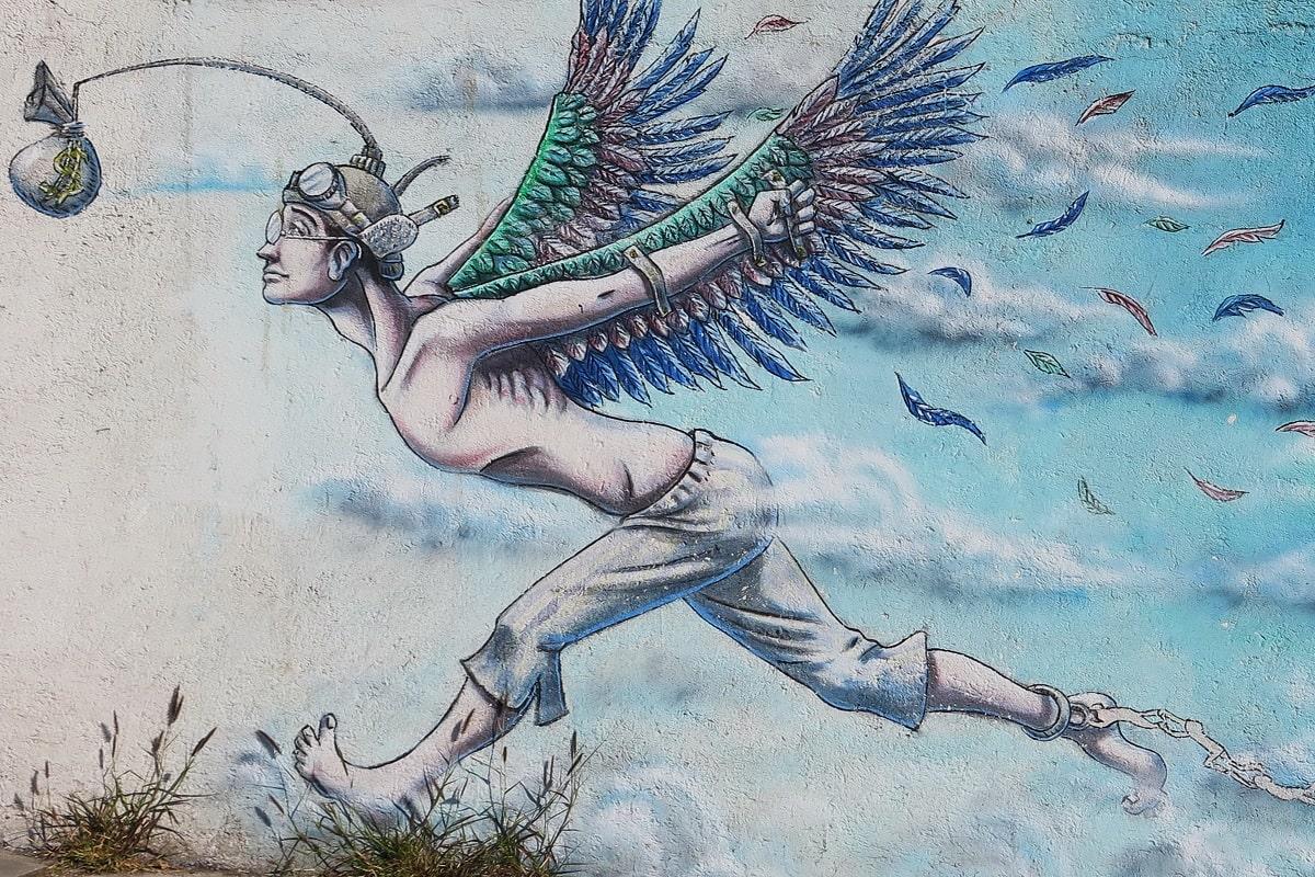 Julian Assange ist Opfer des Systems. Das Graffiti zeigt die Macht des Geldes. (Foto: Arie Wubben, Unsplash.com)