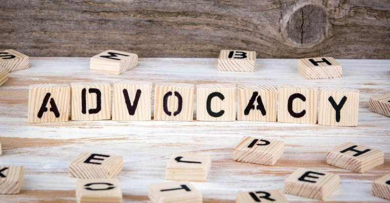 "Wooden blocks similar to scrabble tiles spell out the word ""advocacy"" and are intended to simply be a literal and obvious way to represent the article"