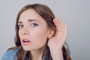 "a woman listening to workplace gossip trying to hear the word ""autistic"" because people whisper it like it's a shameful insult"