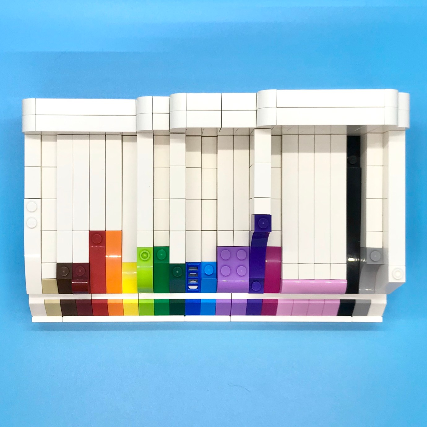 A LEGO slope display, with different slope elements and in a pleasing color order. Top view.