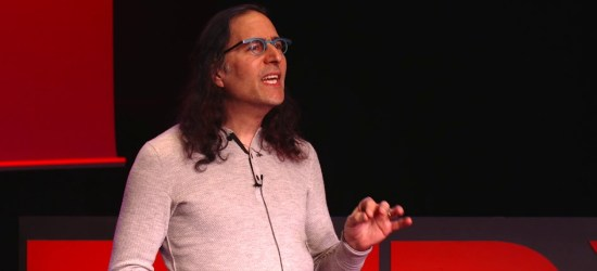 Daniel Maskit, an autistic man, stands on a TedX Talk stage and gives a speech about autism