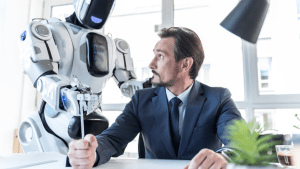 White person in suit at work looking at robot touching them while holding a ruler.