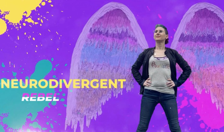 NeuroDivergent Rebel, a slim framed nonbinary human, in a purple graphic background stands in front of a pair of wings - with the text NeuroDivergent Rebel to the left of them