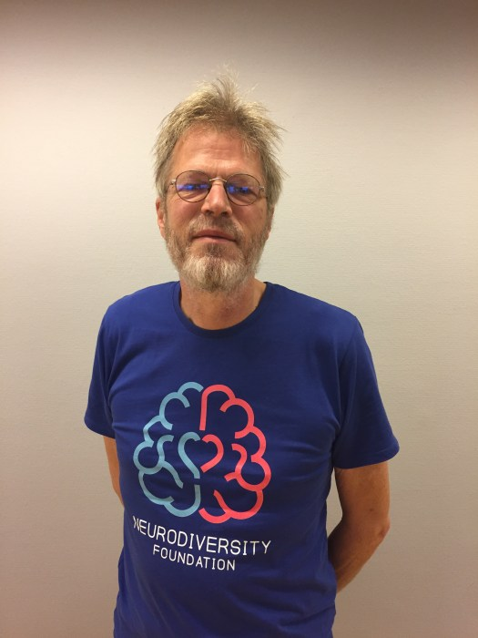 wearing the first version of the Neurodiversity Foundation t-shirt