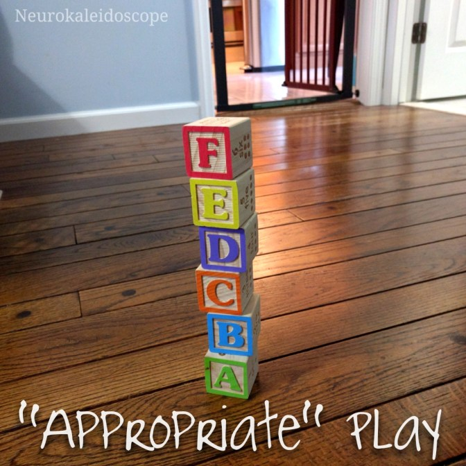 "[Image shows a stack of wooden alphabet blocks with the text ""Appropriate"" Play beneath it.]"
