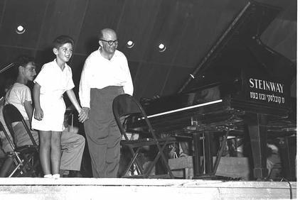 The image shows 11 year old pianist, Danny Barenboim playing at a concert in 1956.