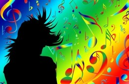 The image shows a silhouette of a person surrounded by colorful music notes.