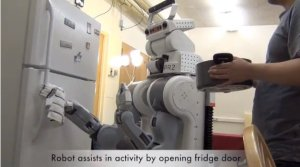 The image shows the robot opening a fridge door.